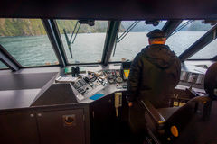 SOUTH ISLAND, NEW ZEALAND- MAY 25, 2017: Close up of a ferry boat with a captain in the command cabin controling the. Ferry, in south island, new zealand Stock Photo