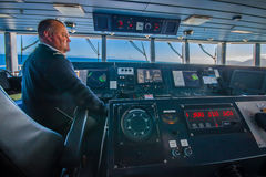 SOUTH ISLAND, NEW ZEALAND- MAY 25, 2017: Close up of a ferry boat pilot command cabin with the captain operating the Royalty Free Stock Photos