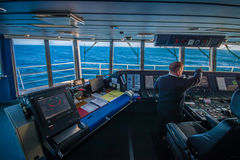 SOUTH ISLAND, NEW ZEALAND- MAY 25, 2017: Ferry boat pilot command cabin with the captain operating the machines with a Royalty Free Stock Photos