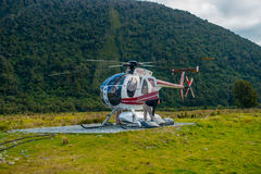 SOUTH ISLAND, NEW ZEALAND - MAY 21, 2017:Helicopter waiting for hunters in South Westland`s Southern Alps, New Zealand Royalty Free Stock Image