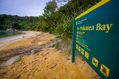 SOUTH ISLAND, NEW ZEALAND- MAY 22, 2017: Informative sign in the beach in Abel Tasman National Park located in South Royalty Free Stock Image