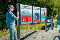 SOUTH ISLAND, NEW ZEALAND- MAY 25, 2017: An informative sign of Franz Josef Glacier National Park, in New Zealand. SOUTH ISLAND, NEW ZEALAND- MAY 25, 2017 Stock Photography
