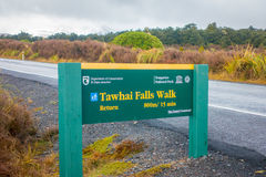 SOUTH ISLAND, NEW ZEALAND - MAY 19, 2017: An informative wooden sign of Tawhai Falls in Tongariro National Park, on the Royalty Free Stock Image