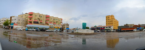 South jeddah city after heavy rain with cloudy gray. Sky and water over land Stock Image