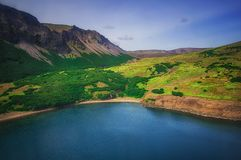 Lake in the Caldera volcano Ksudach. South Kamchatka. Russia. Nature Park. View from the helicopter. South Kamchatka. Russia. Nature Park. Lake in the Caldera stock photos