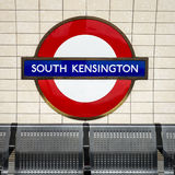 South Kensington tube station sign - London Underground roundel. 25 April 2012: The identifying sign for the London Underground (tube) station on a platform at Royalty Free Stock Photography