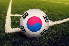 South Korea ball on corner kick position, soccer field background. National football theme on green grass.  stock photography