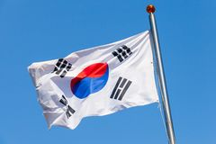 South Korea flag over blue sky. South Korea flag, also known as the Taegukgi waving on a flagpole stock images