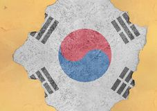 South Korea flag in big concrete cracked hole and broken material. Facade structure royalty free stock image