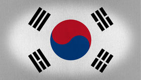 South Korea flag. With a blue and red circle at the center and some characters aroun it over a withe back, fabric texture background vignette Royalty Free Stock Images
