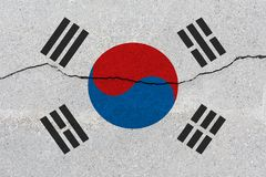 South korea flag on concrete wall with crack. Patriotic grunge background. National flag of South korea stock photo