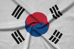 South Korea flag is depicted on a sports cloth fabric with many folds. Sport team banner. South Korea flag is depicted on a sports cloth fabric with many folds stock photo