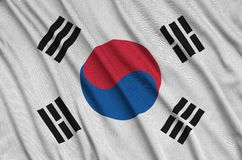 South Korea flag is depicted on a sports cloth fabric with many folds. Sport team banner stock image