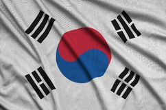South Korea flag is depicted on a sports cloth fabric with many folds. Sport team banner. South Korea flag is depicted on a sports cloth fabric with many folds stock image