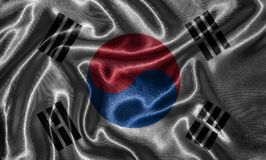 Wallpaper by South Korea flag and waving flag by fabric. royalty free stock image