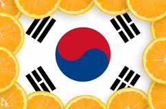 South Korea flag in fresh citrus fruit slices frame. South Korea flag in frame of orange citrus fruit slices. Concept of growing as well as import and export of stock photos