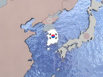 South Korea with flag on globe Stock Image