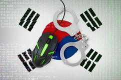 South Korea flag and handcuffed computer mouse. Combating computer crime, hackers and piracy. South Korea flag and handcuffed modern backlit computer mouse royalty free stock photo