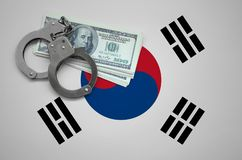 South Korea flag with handcuffs and a bundle of dollars. The concept of breaking the law and thieves crimes stock illustration