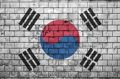 South Korea flag is painted onto an old brick wall vector illustration
