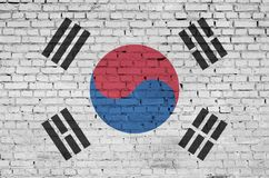 South Korea flag is painted onto an old brick wall stock photo