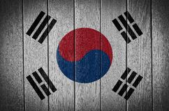 South Korea flag. Painted on wood plank texture background royalty free stock photo
