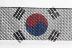 South Korea Flag On a Pimples Plastic Texture. Background close up stock photos
