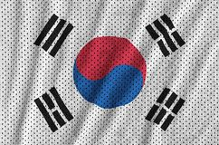 South Korea flag printed on a polyester nylon sportswear mesh fa. Bric with some folds royalty free stock photo