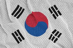 South Korea flag printed on a polyester nylon sportswear mesh fa. Bric with some folds stock photos