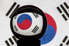 South Korea flag in reflection on a crystal ball. Against a blurred South Korea flag royalty free stock image