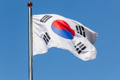 South Korea flag Taegukgi over blue sky. South Korea flag Taegukgi waving on a flagpole royalty free stock photos