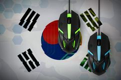 South Korea flag and two mice with backlight. Online cooperative games. Cyber sport team. South Korea flag and two modern computer mice with backlight. The royalty free stock image