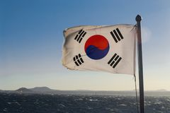 South Korea flag. Waving against clean blue sky, close up, with clipping path mask alpha channel transparency royalty free stock image