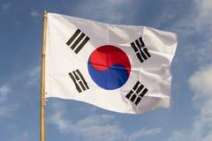 South Korea flag waving against cloudy blue sky. South Korea flag waving against clean blue sky royalty free stock image