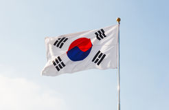 South Korea flag waving with blue sky in background. South Korea flag waving in sky stock photo
