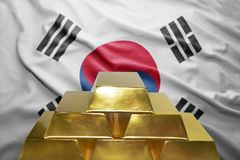 South korea gold reserves. Shining golden bullions on the south korea flag background royalty free stock images