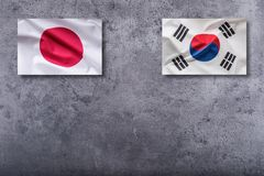 South Korea and Japan flags. South Korea and Japan flag on concrete background.  royalty free stock images
