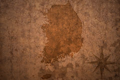 South korea map on vintage paper background. South korea map on a old vintage crack paper background stock photos