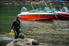 SOUTH KOREA - MAY 19, 2018: Traditional Women-Divers at Jeju Island, also Called as Haenyeo, Gathering Shell-fish in the stock photos