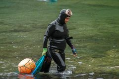 SOUTH KOREA - MAY 19, 2018: Traditional Women-Divers at Jeju Island, also Called as Haenyeo, Gathering Shell-fish in the
