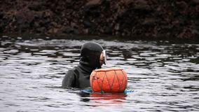 SOUTH KOREA - MAY 19, 2018: Traditional Women-Divers at Jeju Island, also Called as Haenyeo, Gathering Shell-fish in the. Sea shot with a Sony RX10 IV fps59,94 stock video footage