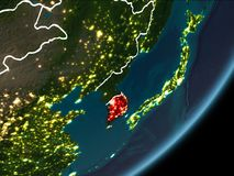 South Korea on night Earth. South Korea as seen from Earth's orbit on planet Earth at night highlighted in red with visible borders and city lights. 3D Stock Images