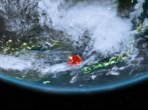 South Korea at night. Highlighted in red on planet Earth with clouds. 3D illustration. Elements of this image furnished by NASA Royalty Free Stock Photography