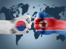 South Korea x North Korea. South Korea and North Korea boxing fists Royalty Free Stock Photos