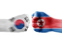 South korea x north korea. Boxing flag hands royalty free stock image