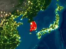 South Korea in red at night. Satellite night view of South Korea highlighted in red on planet Earth. 3D illustration. Elements of this image furnished by NASA Stock Image