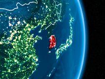 South Korea in red at night. South Korea from orbit of planet Earth at night with visible borderlines and city lights. 3D illustration. Elements of this image Stock Image
