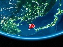 South Korea on planet Earth from space at night. South Korea in red with visible country borders and city lights from space at night. 3D illustration. Elements Royalty Free Stock Images