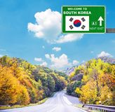 South Korea road sign against clear blue sky. Solomon Islands road sign against clear blue sky royalty free stock images