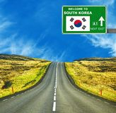 South Korea road sign against clear blue sky. Solomon Islands road sign against clear blue sky royalty free stock photography